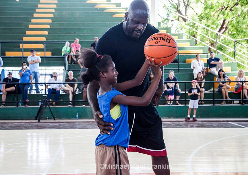 Sports Envoy and NBA legend Shaquille O'Neal instructs a Cuban youth player in shooting technique.  2016.  Photo courtesy of Michael Paul Franklin.