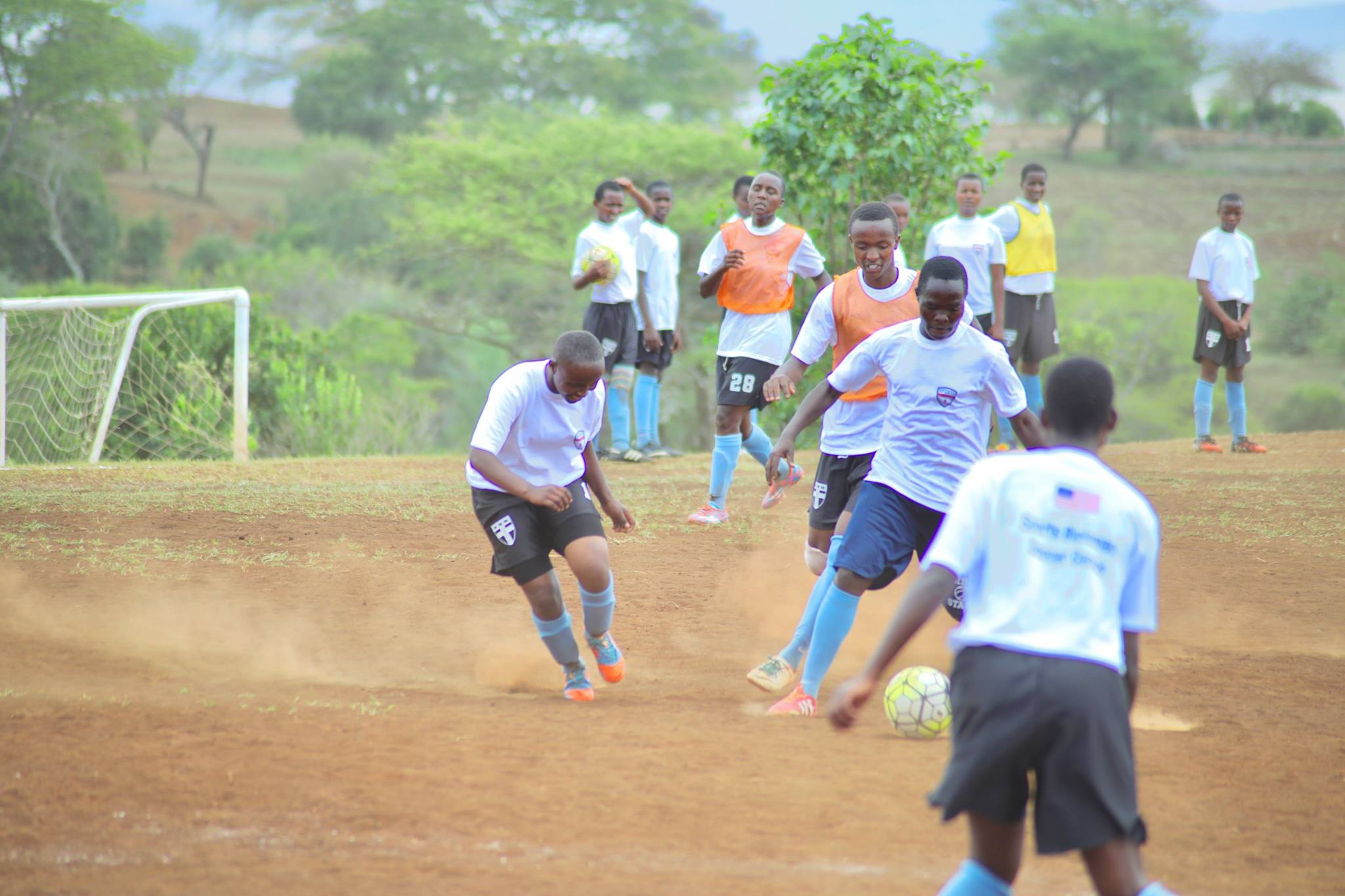 Tanzanian youth participate in soccer drills lead by Sports Envoys and U.S. Women's National Team member, Alex Morgan, and Orlando City player Servando Carrasco.  2017.