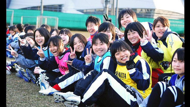 Soccer clinic participants in Japan after session with USWNT in 2013.