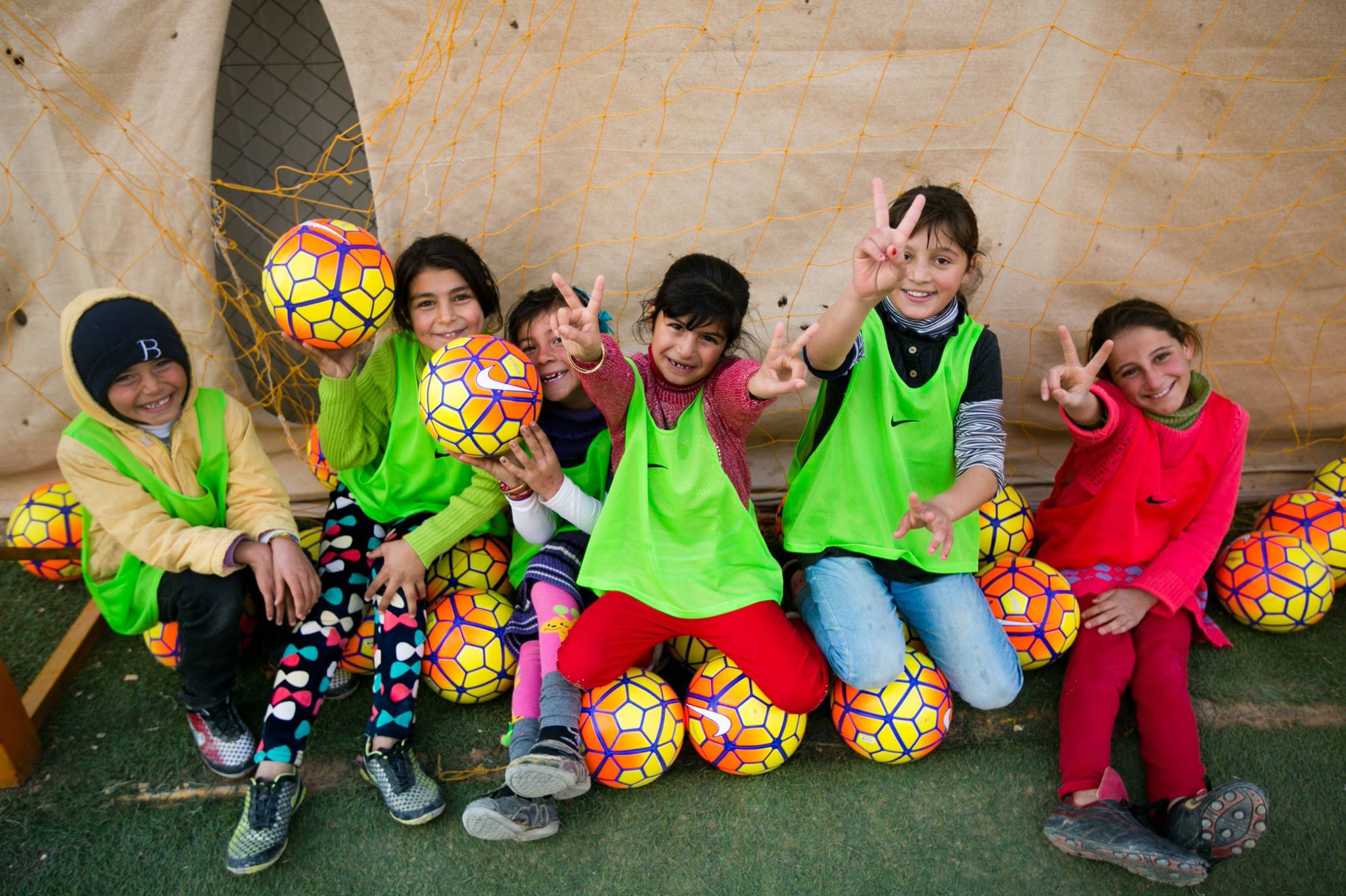 Youth in Jordan celebrate with donated equipment from U.S. Soccer after participating in sports clinics lead by Global Sports Mentoring Alumnae and Mentors. Photo courtesy of Center for Sport, Peace, and Society at the University of Tennessee. 2015.