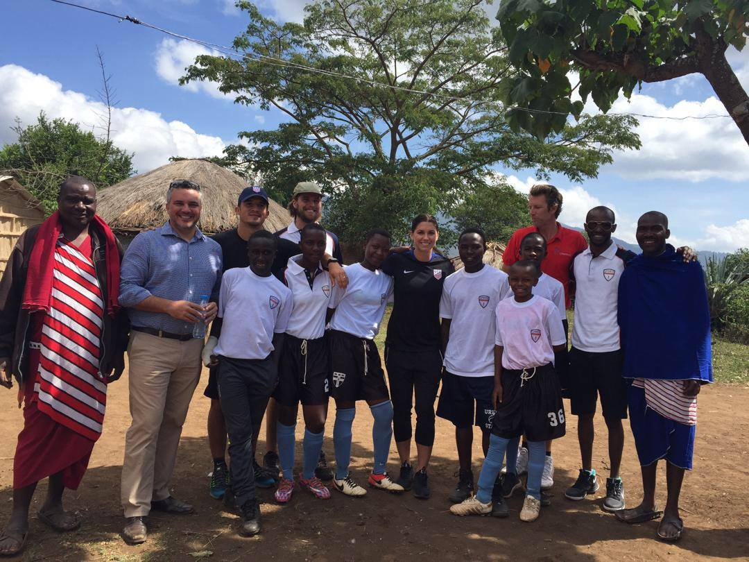 Sports Envoys and U.S. Women's National Team member, Alex Morgan, and Orlando City player Servando Carrasco engage with youth and community leaders in Tanzania.  2017.
