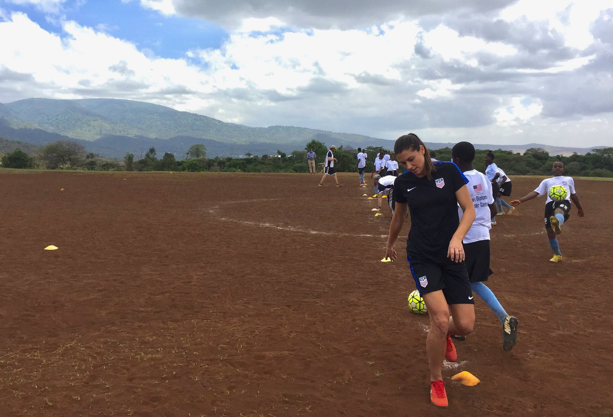 Sports Envoys and U.S. Women's National Team member, Alex Morgan leads soccer drills in Tanzania.  2017.