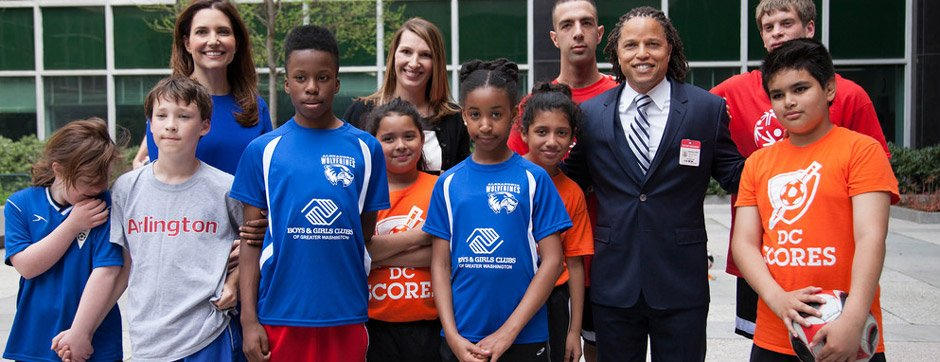 Sports Envoy and former U.S. Men's National Team member, Cobi Jones, joins D.C.-area youth and former U.S. Department of State Deputy Secretary for Management, Heather Higginbottom, and former ECA Assistant Secretary, Evan Ryan, at an event celebrating the 2014 FIFA World Cup, at the U.S. Department of State. 2014.