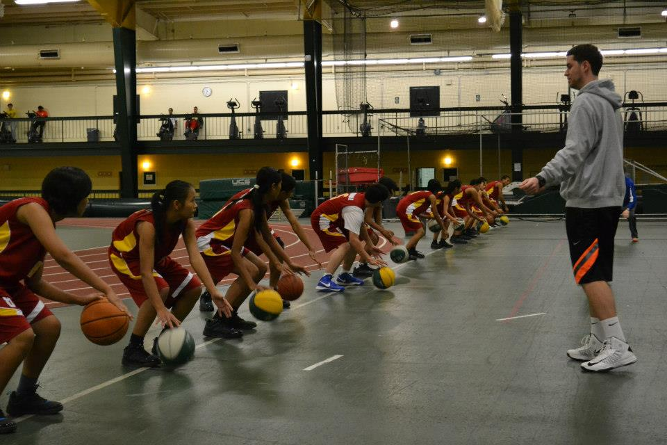 Sports Visitors from Burma participate in a dribbling session in Washington, D.C. 2013.