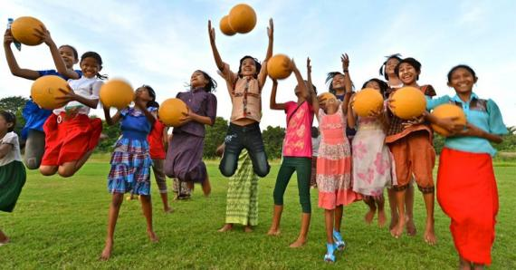 Youth in Burma enjoy new One World Play Project soccer balls. 2013.
