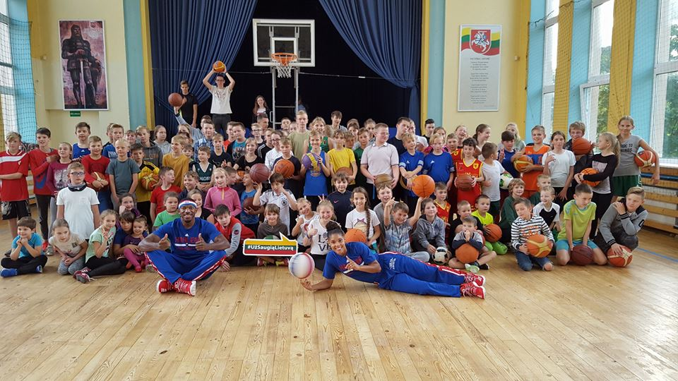 """Sports Envoys and Harlem Globetrotters Anthony """"Bucket"""" Blakes and Crissa """"Ace"""" Jackson lead basketball activities with youth in Lithuania. 2017."""