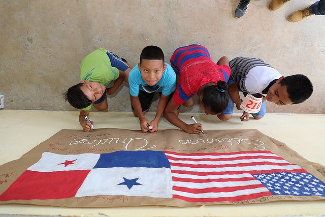 Kids working on a group poster.