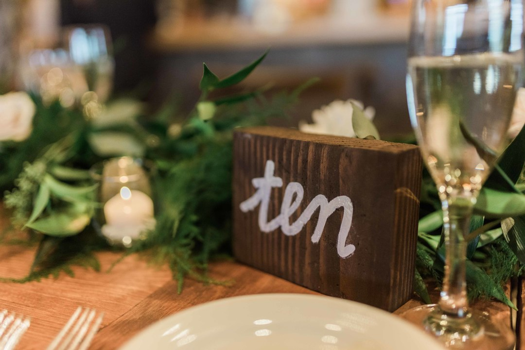 Wooden Table Number. Photography by  Michelle Kujawski Photography  , Floral design by  Modern Bloom