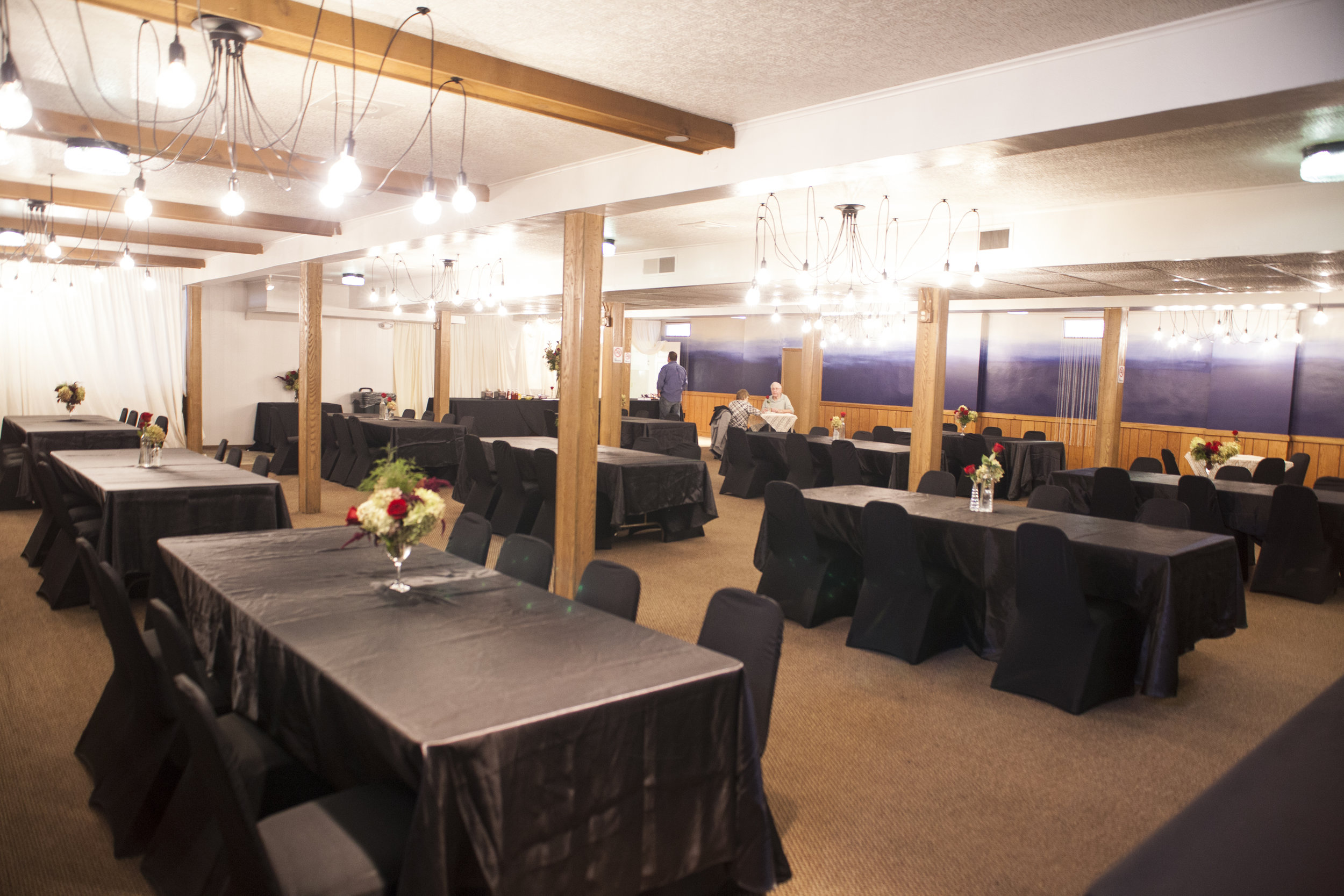 DINNING ROOM LEVEL 1- SEATED CAPACITY 200  Features: Industrial Tentacle Chandeliers, Ombre Accent Wall, Private Bar & Lounge, Round or long tables, Table Linens, Chair Covers