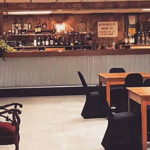 BAR/LOUNGE - UPPER AND LOWER LEVELS  Features: Retro Steel, Bar Lighting, Wood Fireplace Mantel, Flocked Wallpaper, Vintage Lighting, 1930s Red Velvet Settee, Antique Barn Pulleys
