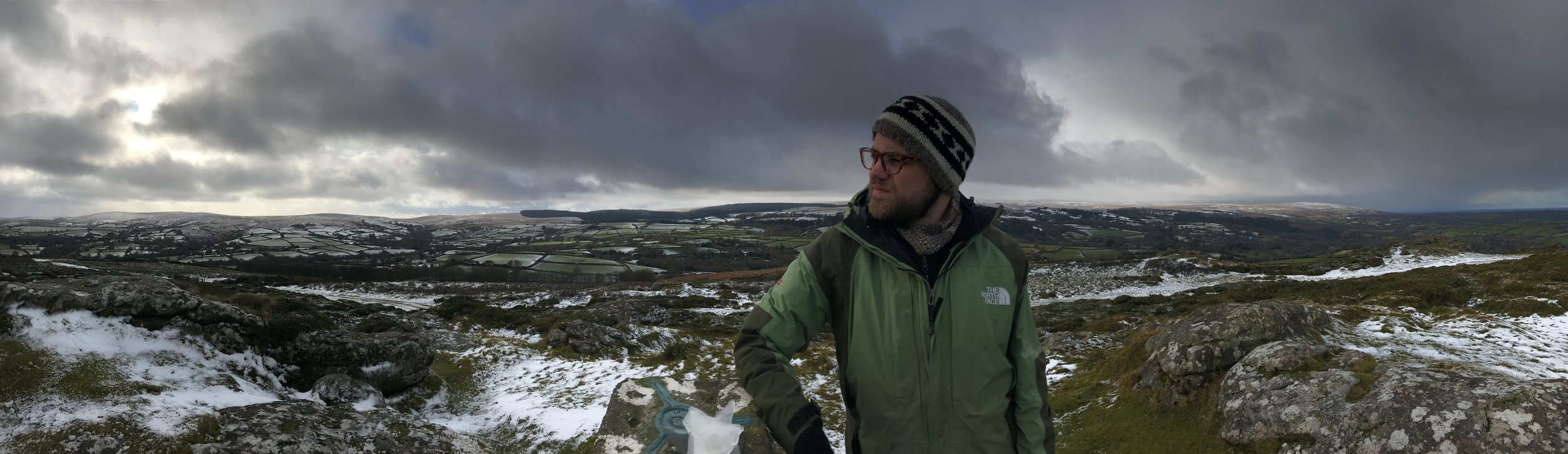 Joe at the top of Meldon Hill with views of Tors to the South