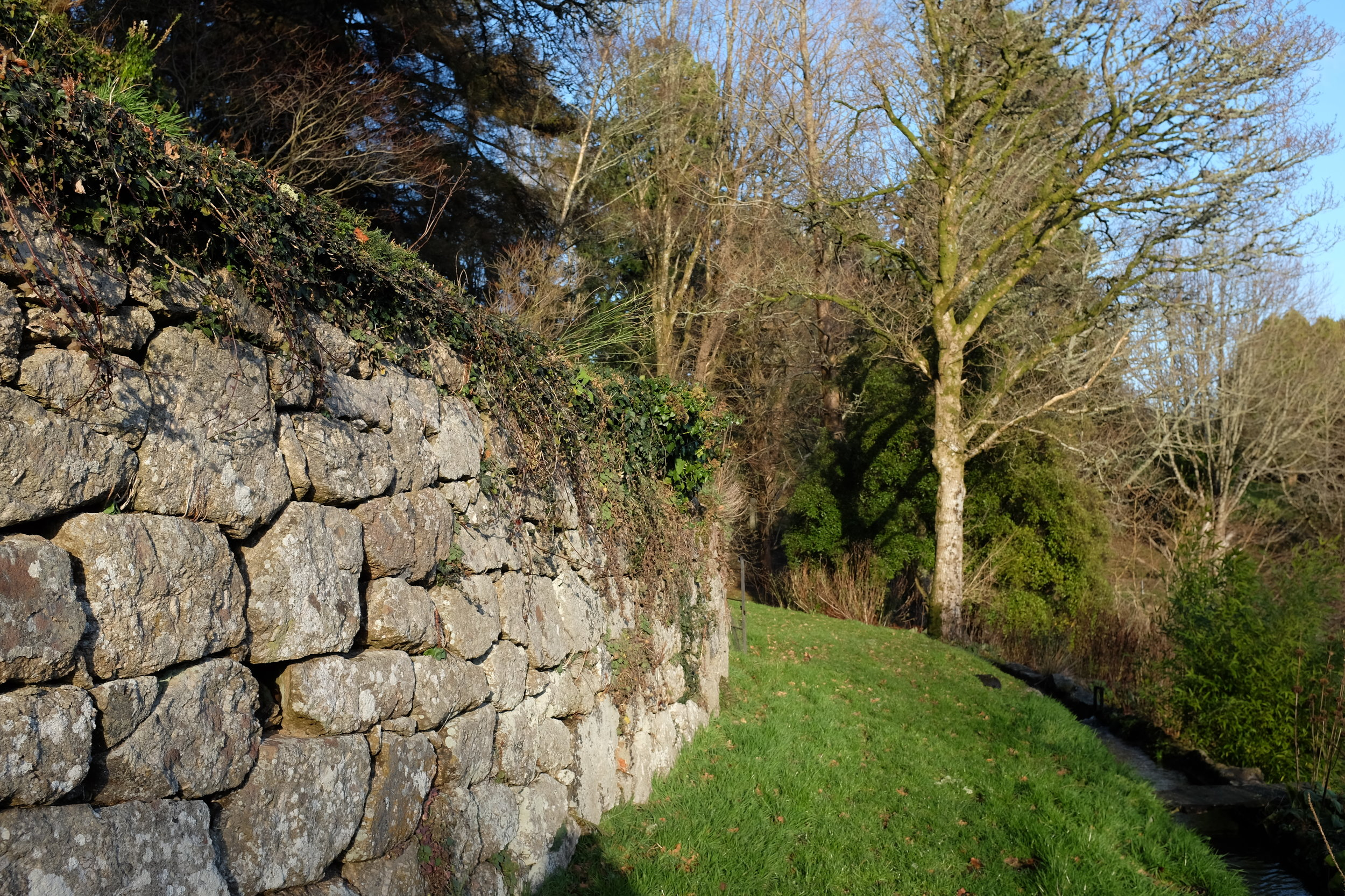Granite wall and St Olaves leat