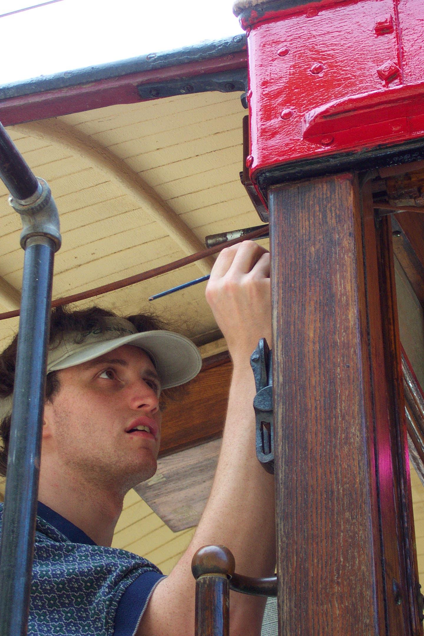 BSM Member Justin Thillman Working on collection car 554. Image Credit: John La Costa