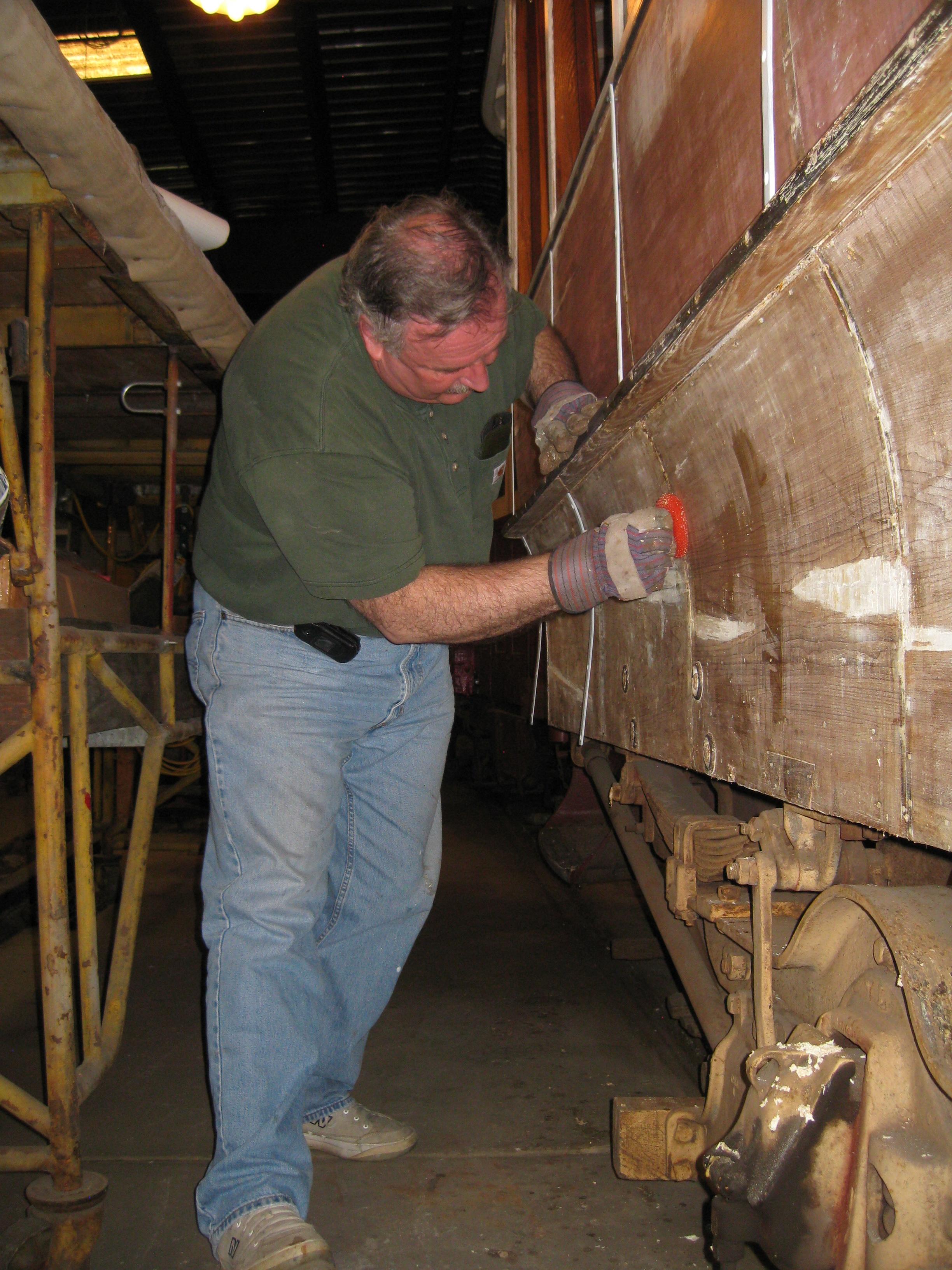 BSM Member Dave Wilson restoring a collection car. Image Credit: John La Costa