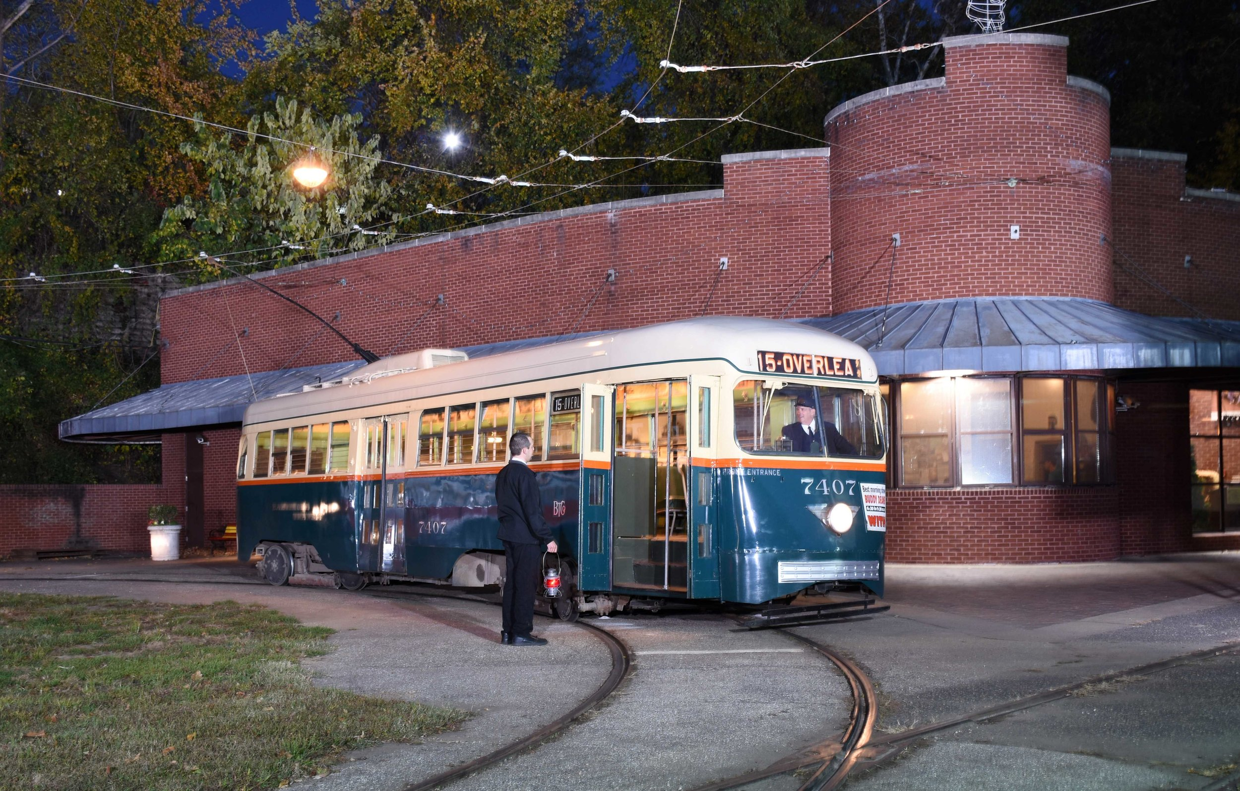 Car 7407, Year 1944 Image Credit: Bill Monaghan  Before the advent of light rail in the 1970s, PCC cars were the highest form of streetcar development achieved in North America. They evolved from a design by the Presidents' Conference Committee (hence the designation PCC), a group of street railway executives and car builders who first convened in the late 1920s to design a modern, fast, comfortable, and quiet standardized streetcar to win back riders from the ever-more-popular automobile. In 1936, Baltimore became the second city, after Brooklyn, New York, to place an order for the new cars, which eventually totaled 5,000 in use throughout most principal cities in the United States, Canada and Mexico. Baltimore Transit purchased a large fleet of PCCs (275 in all), the first order from the St. Louis Car Company of St. Louis, Missouri and the balance from the Pullman-Standard Car Manufacturing Company. One of the latter, No. 7407 was among the last group of streetcars purchased in 1944. It can comfortably seat 54 passengers, has rapid acceleration, high speed (at least 42 miles per hour), and a smooth ride. No. 7407 was the last streetcar to operate on the streets of Baltimore on November 3, 1963. It is worth noting that even though the last PCC cars were built for the North American market in 1952, a number still operate in revenue service in several United States cities.