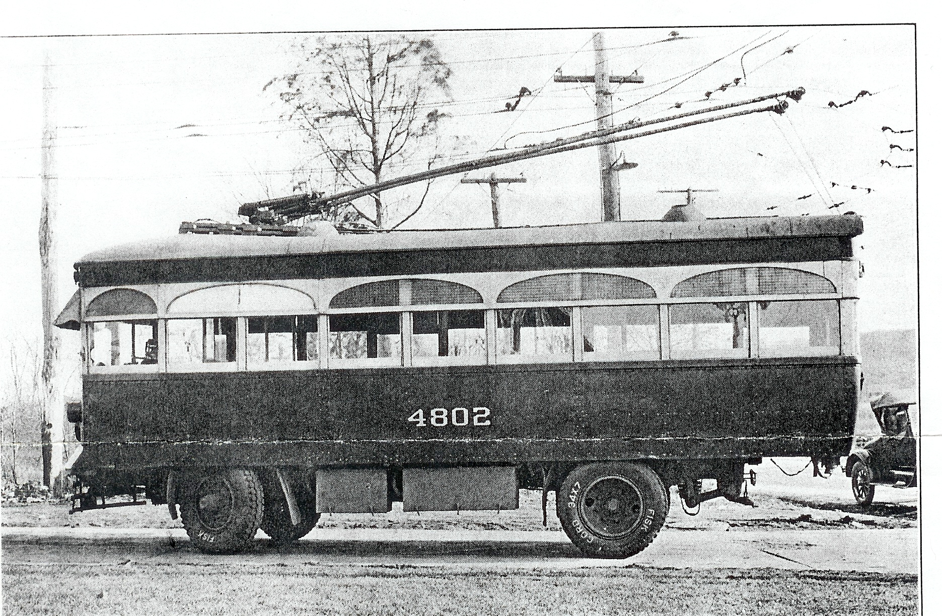 Trackless Trolley 4802, Year 1922 Image Credit: Maryland Rail Heritage Library  Marking Baltimore's first foray into trackless trolley operation (electric vehicles running via twin trolley poles and overhead current but using rubber tired instead of steel wheels and rails), No. 4802 was one of three such vehicles built by Brill for the United. No. 4802 and her sisters were to see service on only one route, on Liberty Road from Gywnn Oak Junction to Randallstown, starting in 1922. Real estate developers had hoped for a streetcar line to serve this growing suburb, but the United felt the expense not justified due to light ridership. Service by trackless trolley was the compromise. After ten years of operation, these vehicles, which seated 22 passengers, were supplanted by buses in July 1932, marking the first time internal combustion engines had replaced electricity as a means of power on the Baltimore system.