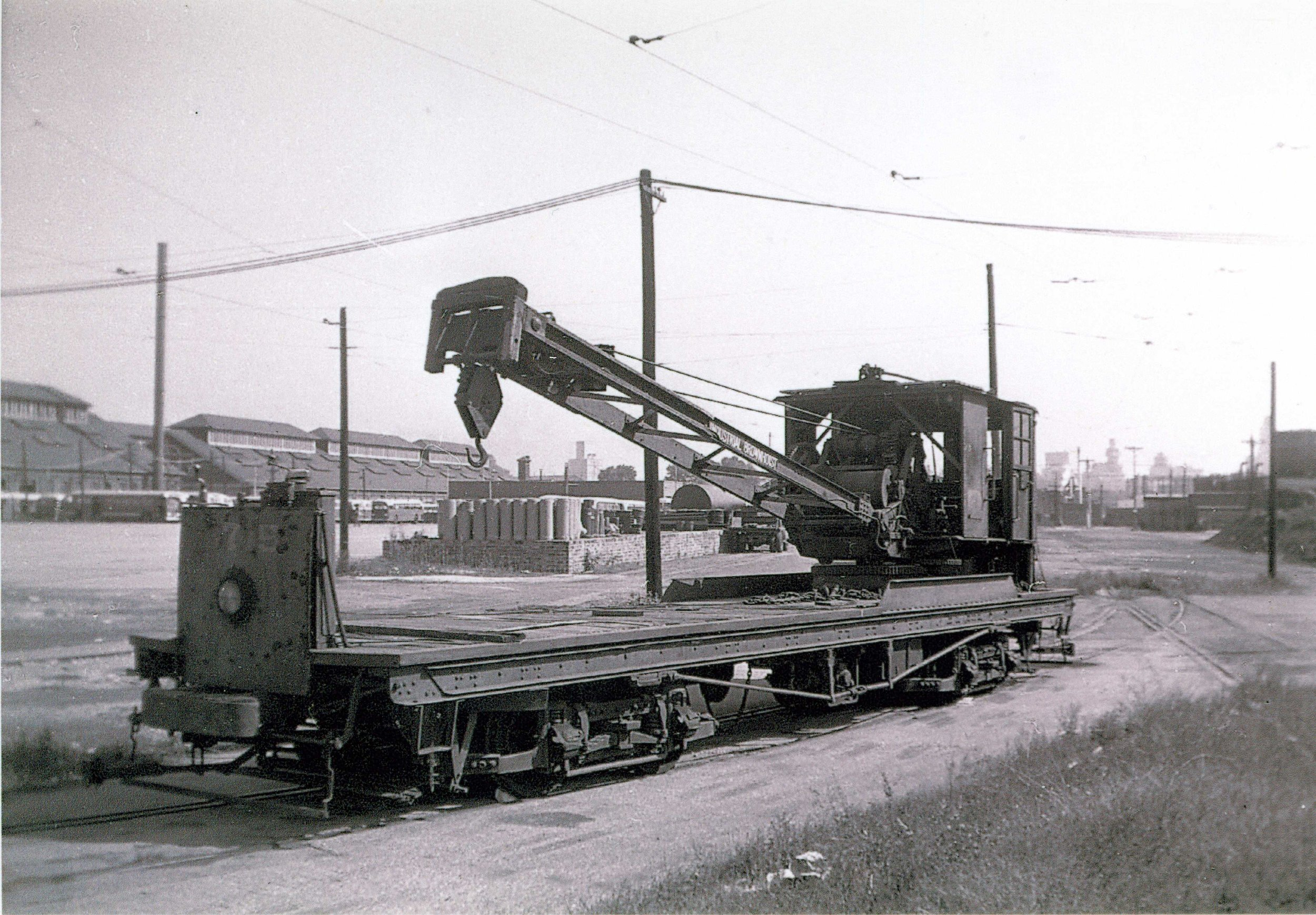 Crane 3715, Year 1913 Image Credit: Maryland Rail Heritage Library  Virtually every street railway system had its fleet of work cars— custom-built vehicles or homemade adaptations of former passenger cars. They performed a litany of unglamorous yet essential tasks, including grinding, placing and removing rail; servicing overhead wires; clearing snow; weeding the right of way; and cleaning streets. One of the only two pieces of Baltimore work equiptment to be preserved (overhead line truck No. 501 is the other), No. 3715is an electric crane car. The crane portion was built by Brownhoist and the carbody by the United. No. 3715 was used for a variety of tasks, including track placement and extraction, and the setting of line poles. Lifting capacity was five tons. The crane was upgraded by its new owners, Baltimore Transit, in 1938. After its withdrawal from service in the mid 1950s, the crane was purchase in 1956 by the Branford Trolley Museum in Branford, Connecticut, where it performed many of the same activities while on duty in Baltimore. In 1998, it was acquired by the BSM, bringing it back home after more than 40 years.