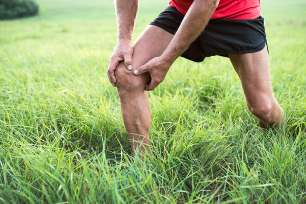 graphicstock-unrecognizable-active-senior-runner-outside-in-field-man-with-injured-knee-close-up-green-sunny-summer-nature_S_z2hWqHGZ-e1511807000150.jpg