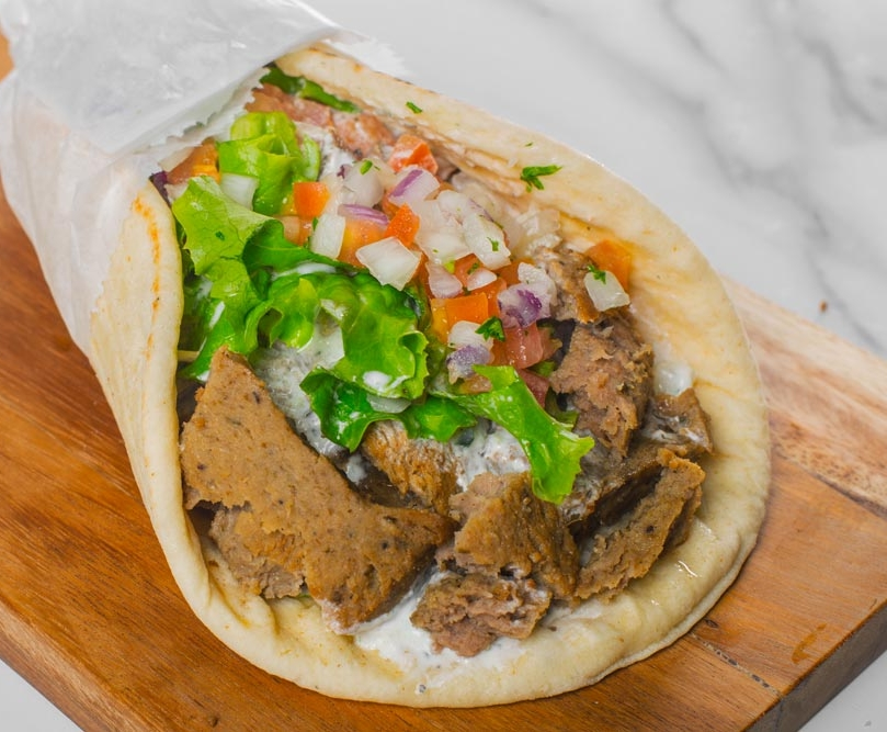 Vasken's Famous Gyro - This classic is one you need to try! Made with our homemade tzatziki sauce, lettuce, tomatoes, and onions, served on a toasted pita.