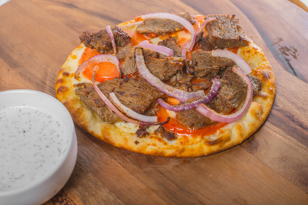 Gyro Pizza served with a side of taziki
