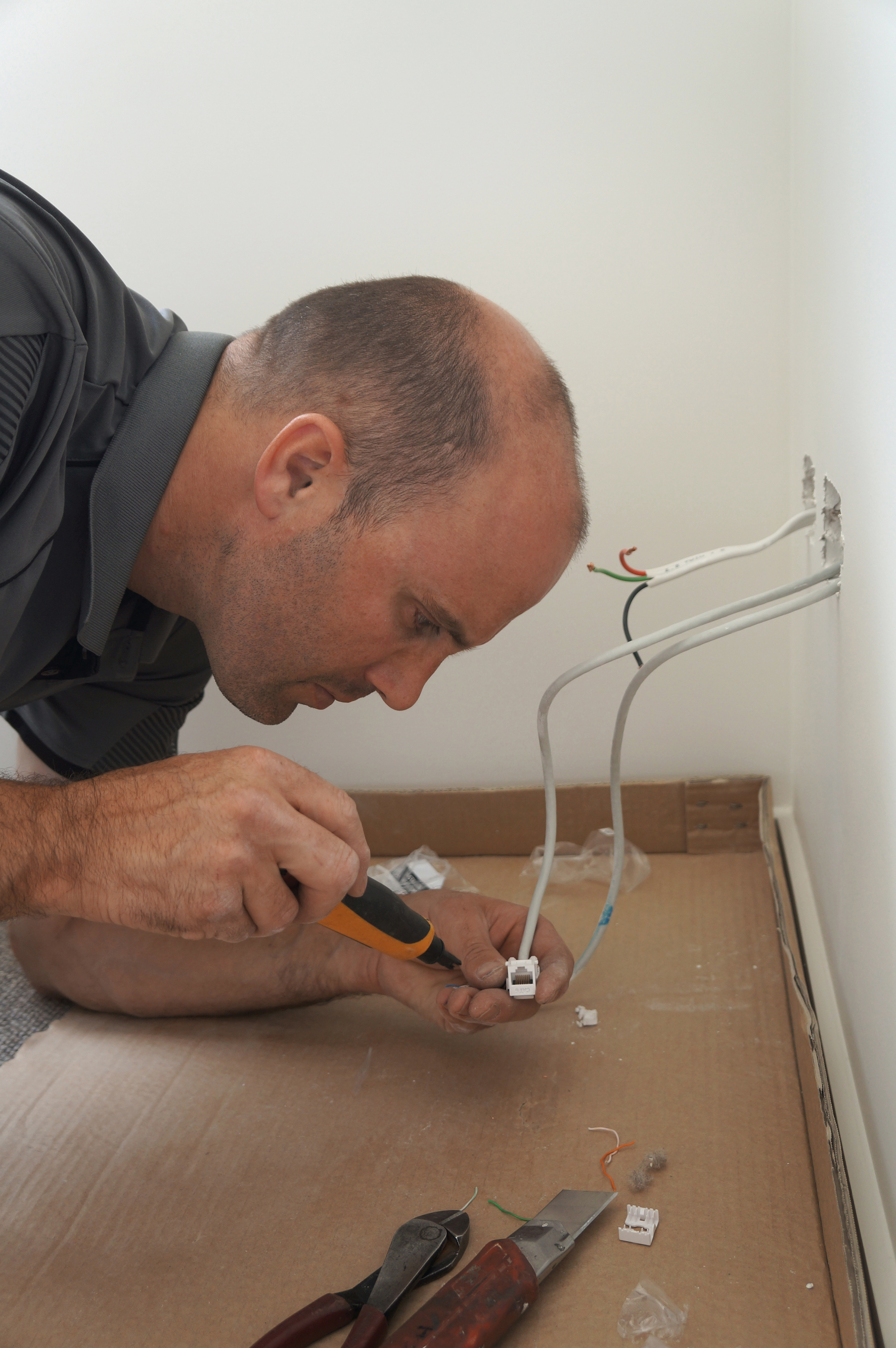 Josh Eves Registered Electrician, fitting a data outlet