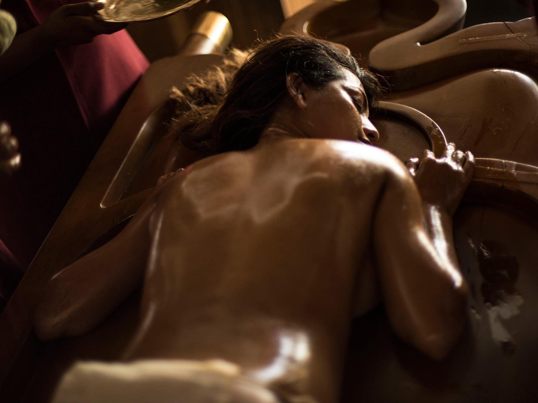 Abhyangam massage at a heritage Ayurveda retreat.