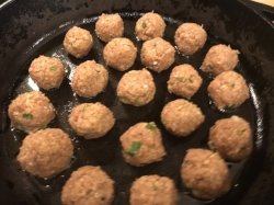 8. Place meatball onto a pan on medium (6-7) heat to pan-sear the outside to lock in the juices and flavors