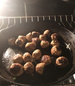 9. Place the meatballs into a preheated oven set at 375 degrees for 10 minutes to finish cooking
