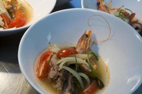 Sinigang, a savory-sour soup with pork and shrimp.. | Michele McDonald for the Boston Globe