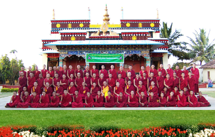 monks+infront+of+monastery+in+exile.jpg