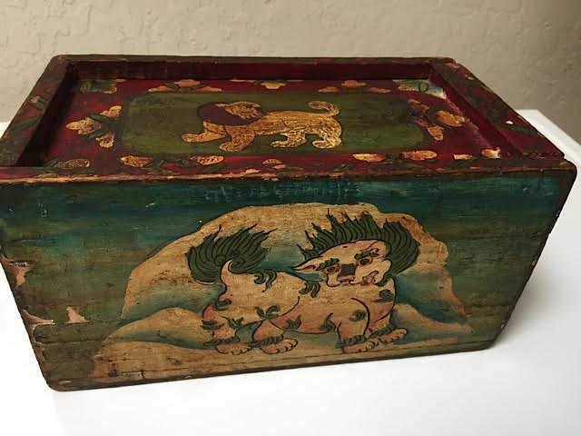 Wooden box with painted Tibetan animals