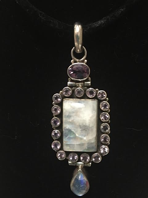 2 inch crystal pendant with amethyst stones