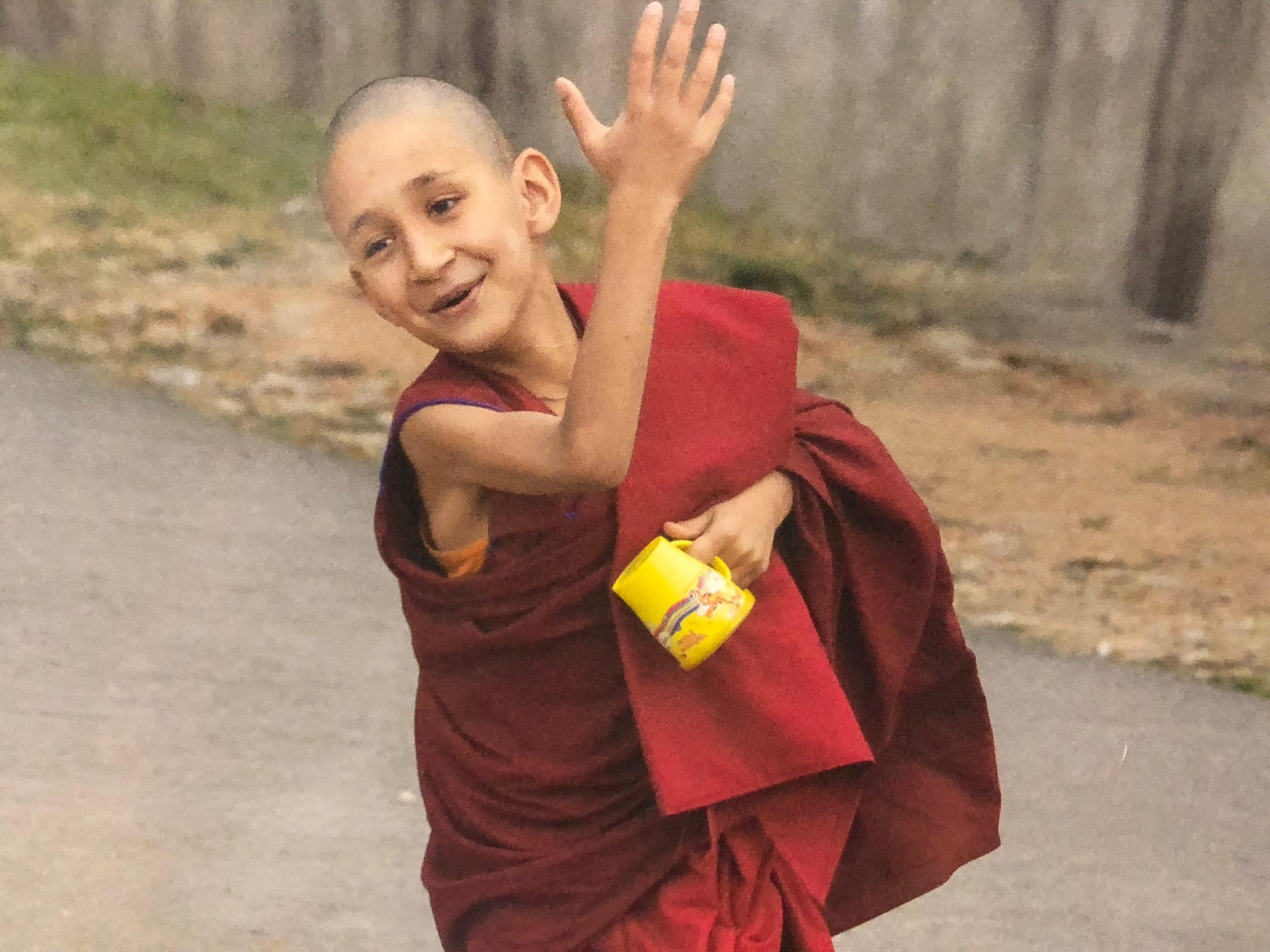 181_Legault-photo of young monk with yellow cup.jpg