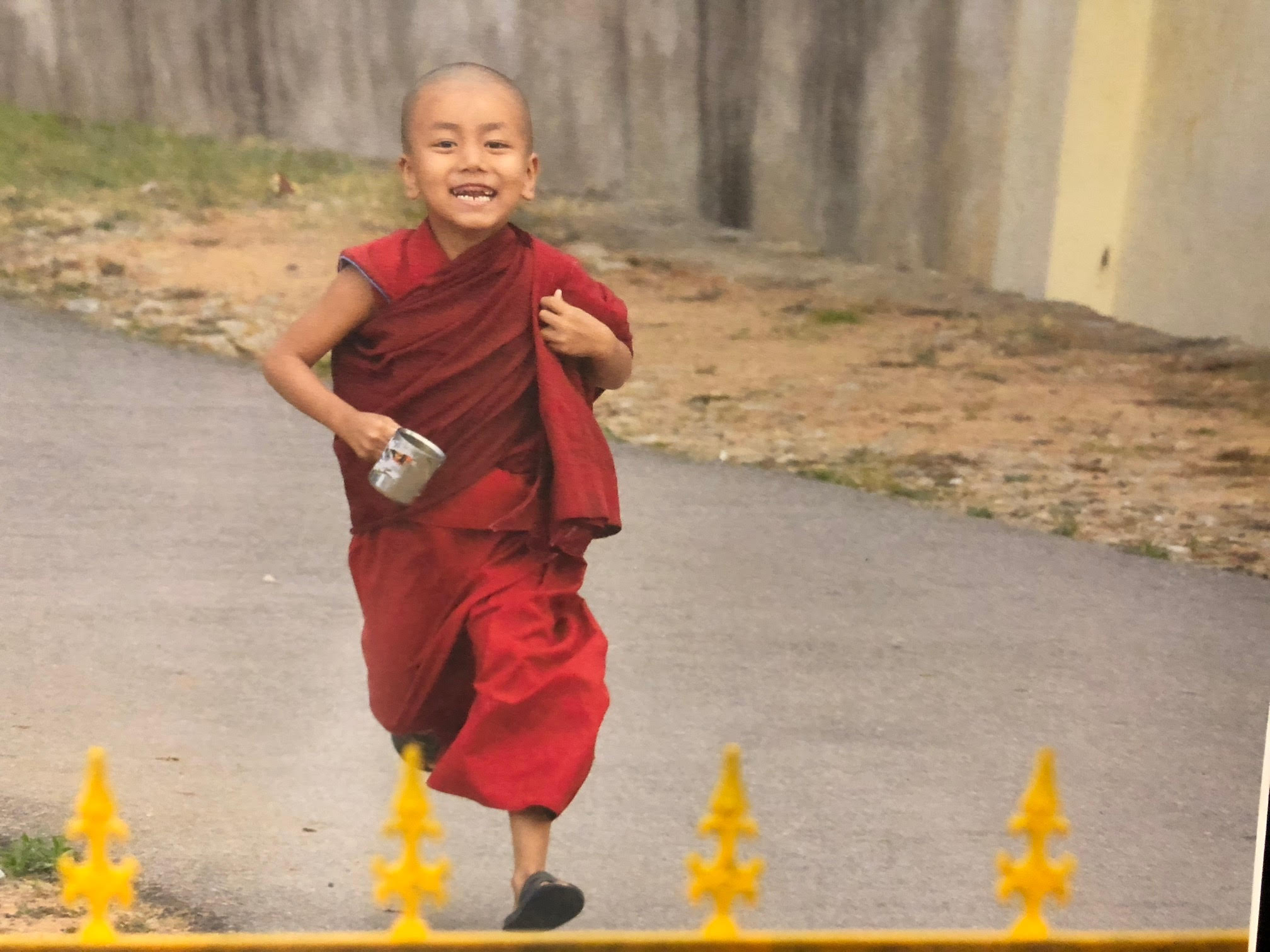 182_Legault-photo of young monk running with silver cup.jpg