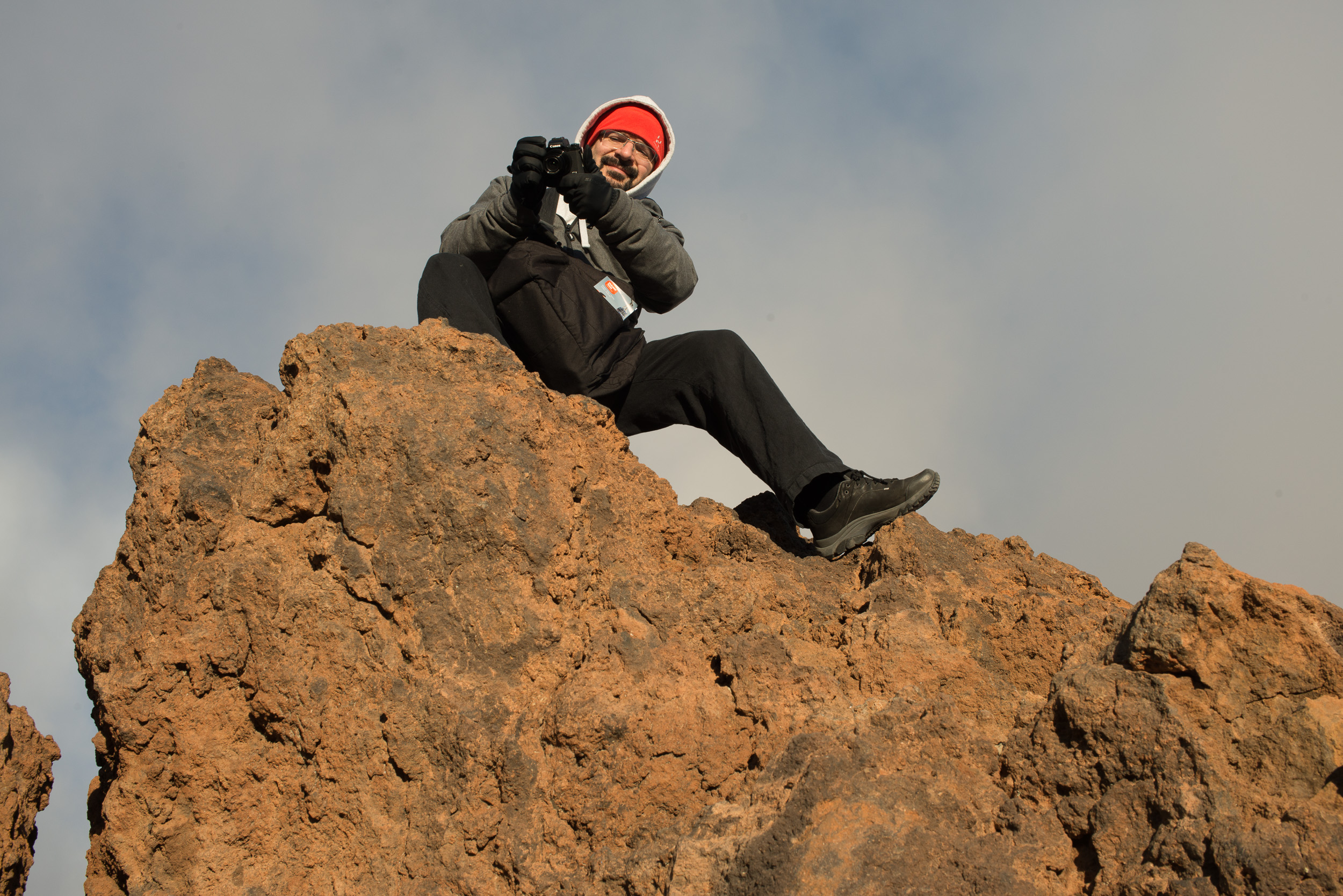Here I am on the top of a rock to have a higher view to take photos. I definitely wouldn't do this carrying any heavy camera. You can't hardly see the camera in my hands in this photos, because it's so small that it's almost hidden between my gloves.:D Photo: Mikko Lyytikäinen