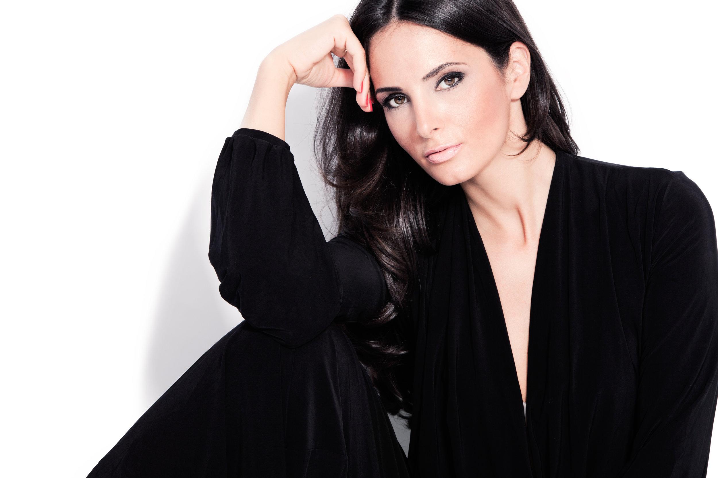 Woman Wearing Black Dress-107582456-ShutterStock.jpg
