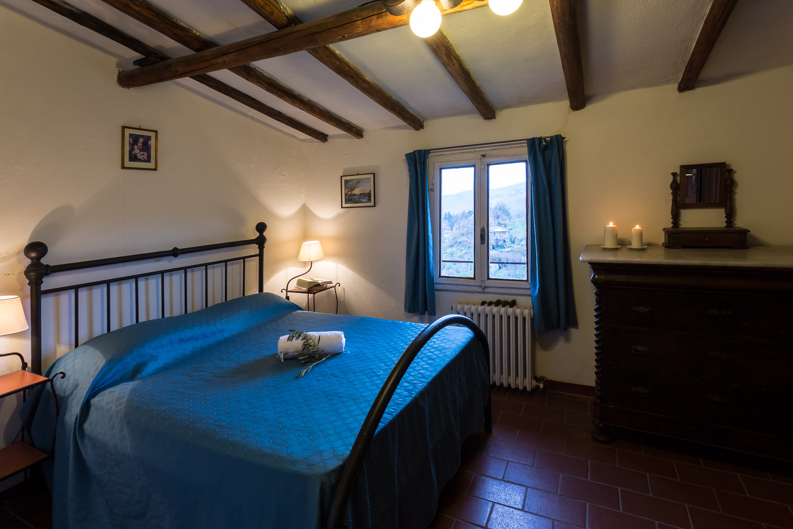 The Castle Studio - Fit for one, but spacious enough for two or 3, the Studio Apartment has a queen size bed, a single bed, closet, and writing desk with wooden chairs. This Castle Studio also features a kitchenette with basic tools for making pasta & coffee as well as a bathroom.