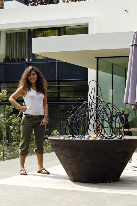 Cathy Azria standing next to her Loop Farandole 4, part of a landscape project in Wimbledon, London