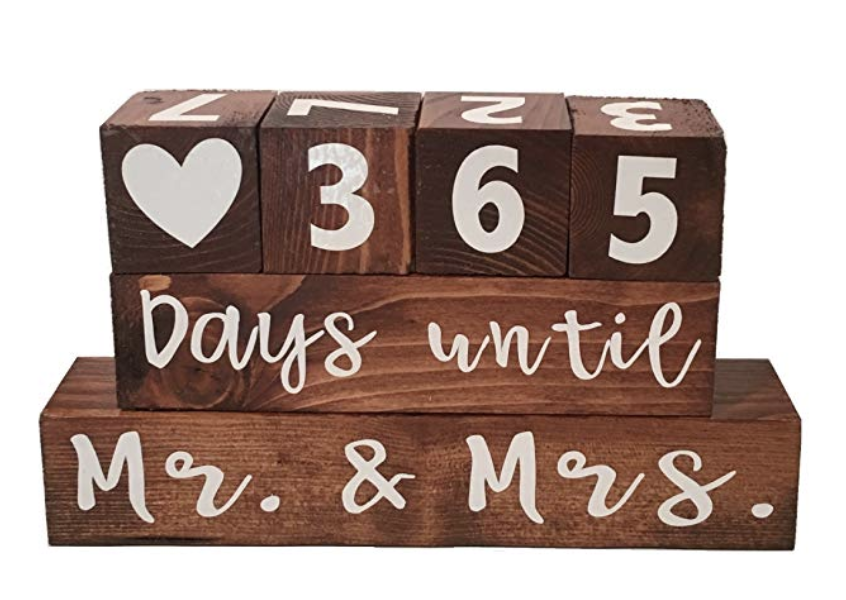 "Wedding Countdown Calendar - Count down the days to the big day with this wooden wedding countdown calendar. Adjust the blocks daily to count down towards your wedding and after you tie the knot, flip it to the other side and use it as an anniversary tracker to count upwards from ""years since we said I do""."