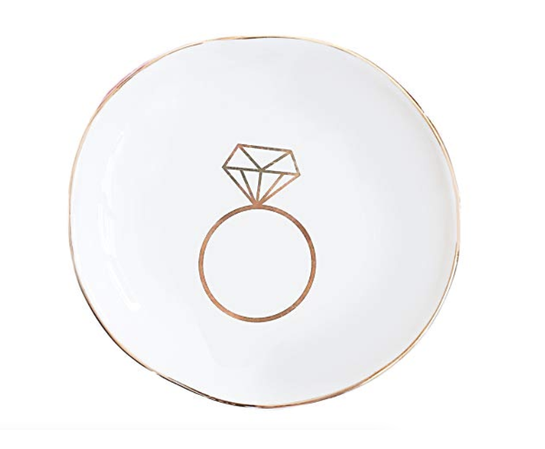 Engagement Ring Dish - Stash your sparkler safely with this cute engagement ring dish. This ceramic trinket tray will keep your engagement ring soap free while showering and prevent it from getting damaged while washing dishes.
