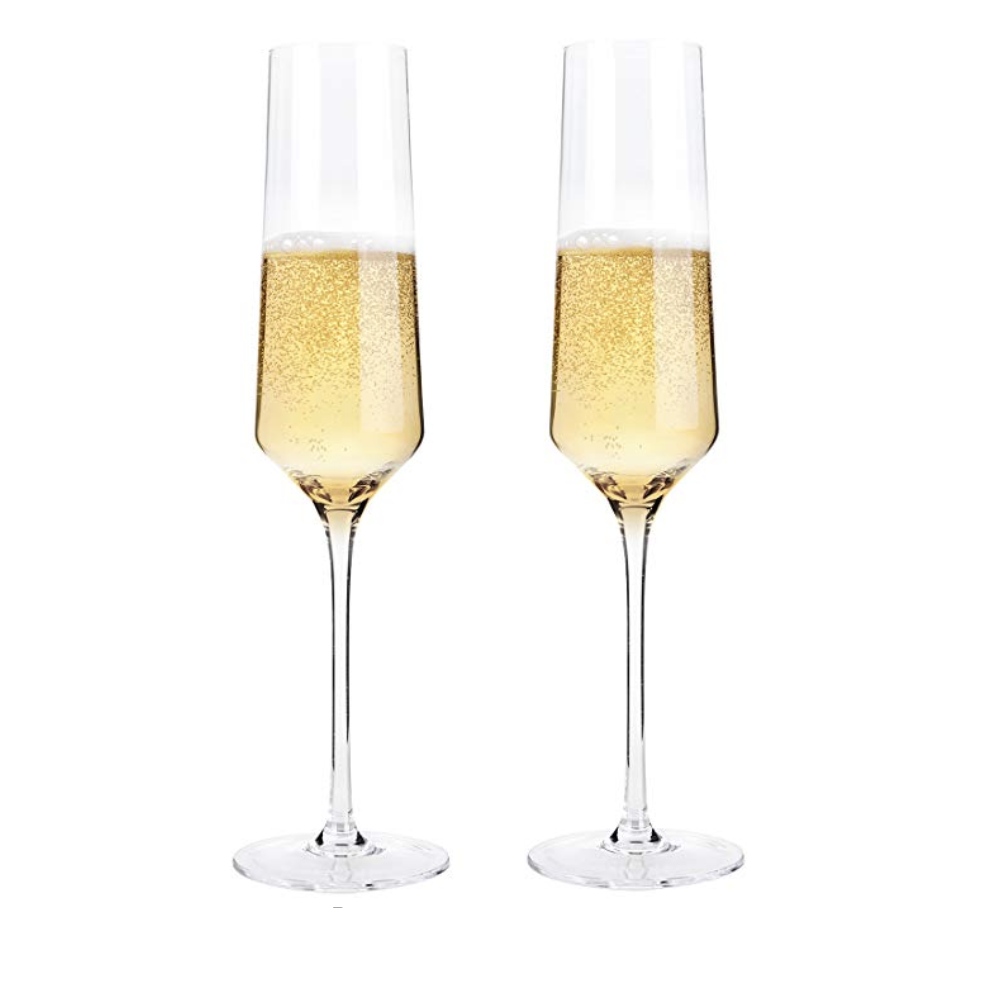 Champagne Flutes - Engagements and weddings mean lots of toasts in your honor, so say cheers with these hand blown crystal champagne glasses. Raise a glass with them at your wedding and save them for sipping champagne on your anniversary for years to come.