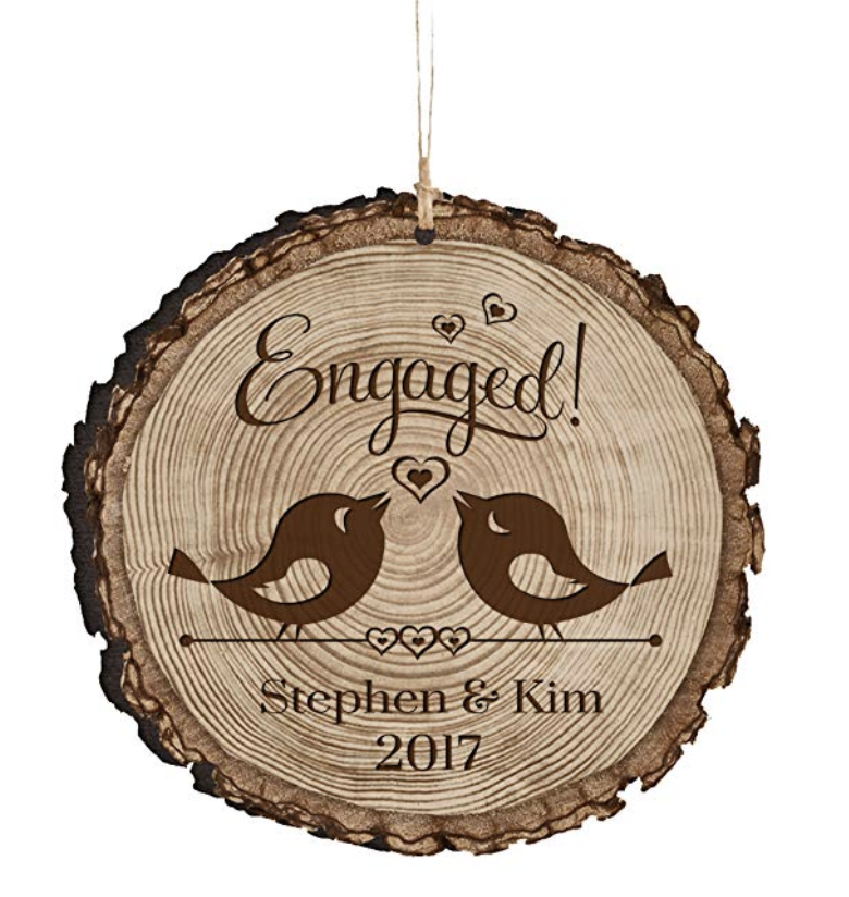 Personalized Engagement Ornament - Celebrate your engagement with this personalized engagement ornament. Featuring two sweet little lovebirds this wooden milestone ornament can be personalized to include your names and the date of your engagement.