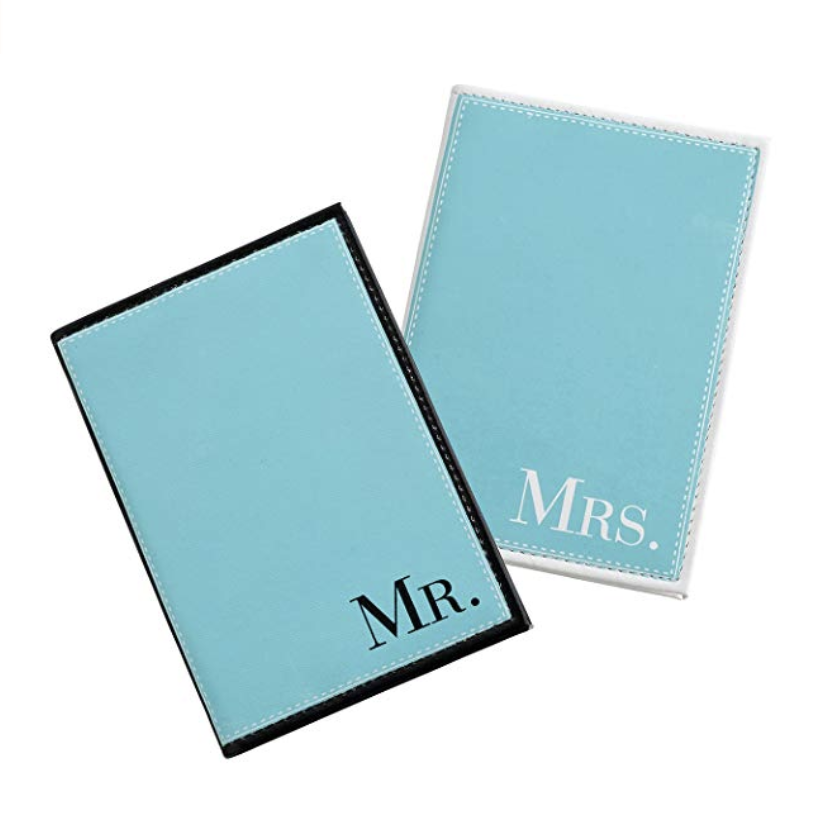 Mr. and Mrs. Passport Holders - Give your passports some panache with these matching Mr. and Mrs. passport holders. The blue leatherette passport covers fit standard size passports and are a perfect way to kick off your honeymoon in newlywed style.