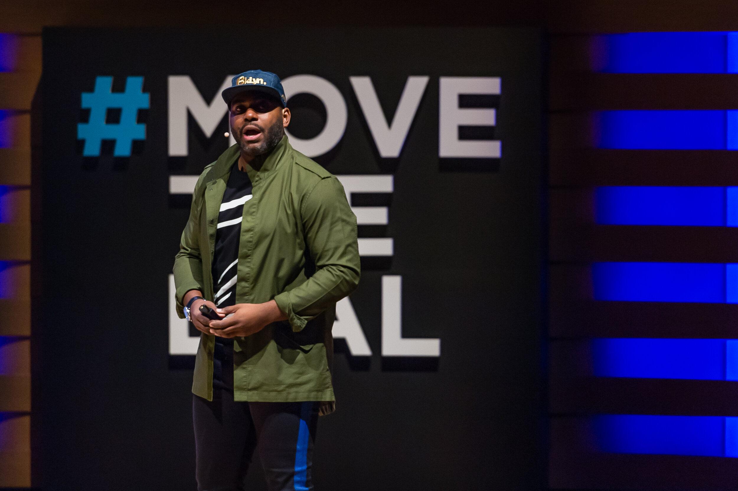 Damien Hooper-Campbell speaking at the inaugural Global Summit.