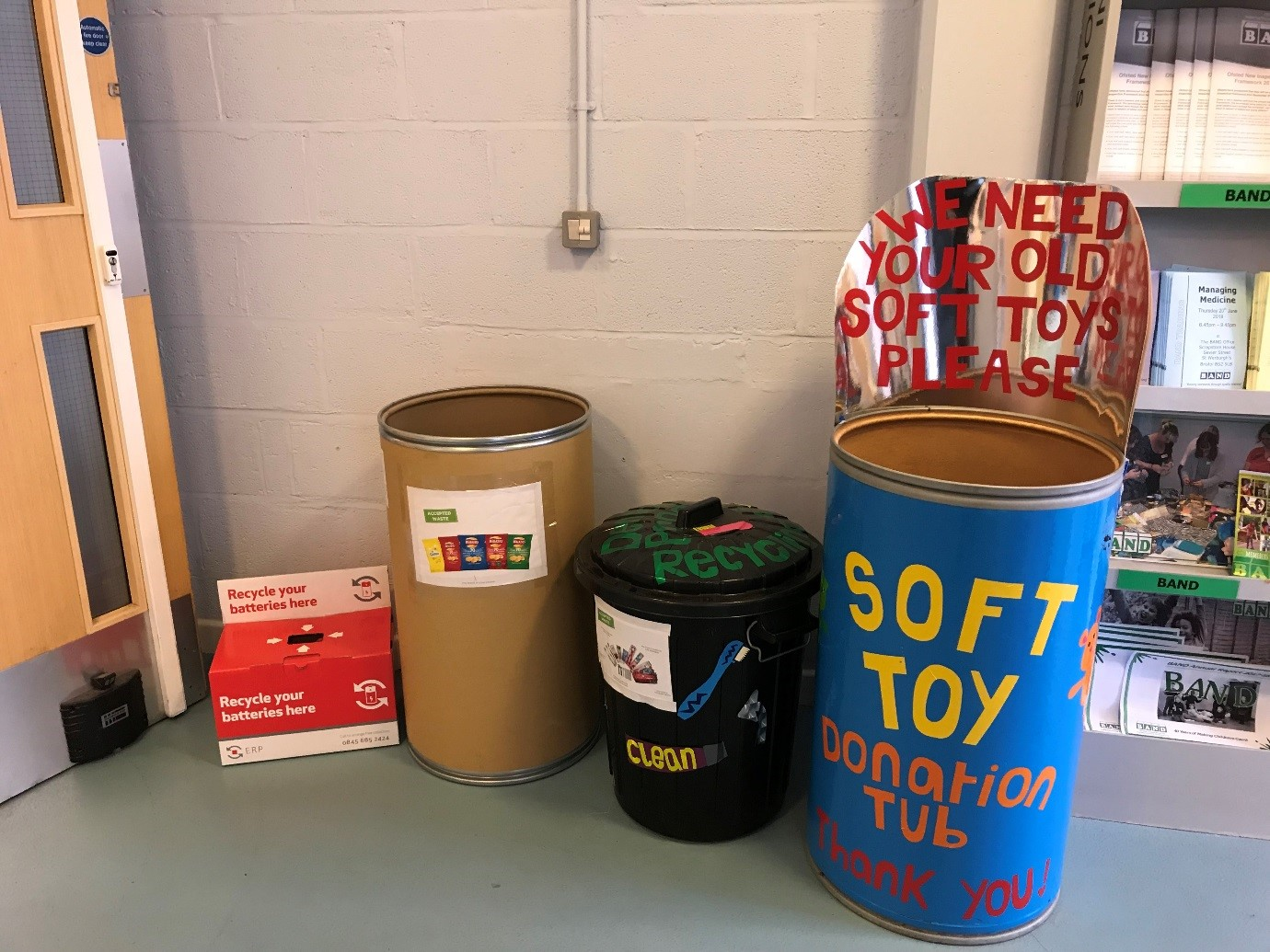 The recycling area at Scrapstore House, from left to right: batteries, crisp packets, oral hygiene waste, and soft toys.