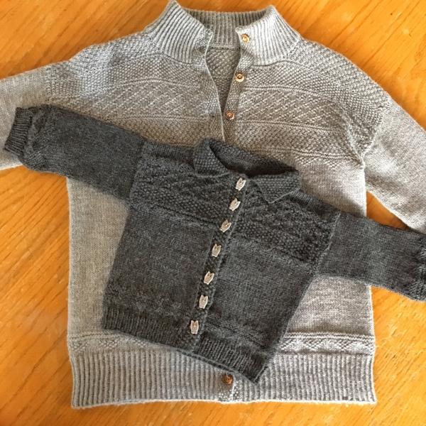 Guernsey Girl for Children (and Ladies) - The little charcoal Guernsey Girl for Children (which, to my eye, is a perfectly unisex sweater) is finished, including owls on the ribbon that backs the button band, and owl buttons. You can see here that though the adult and child versions differ in yarn weight, collar design, and repetition of the textured motifs, they really are a matched pair, and both were great fun to knit.