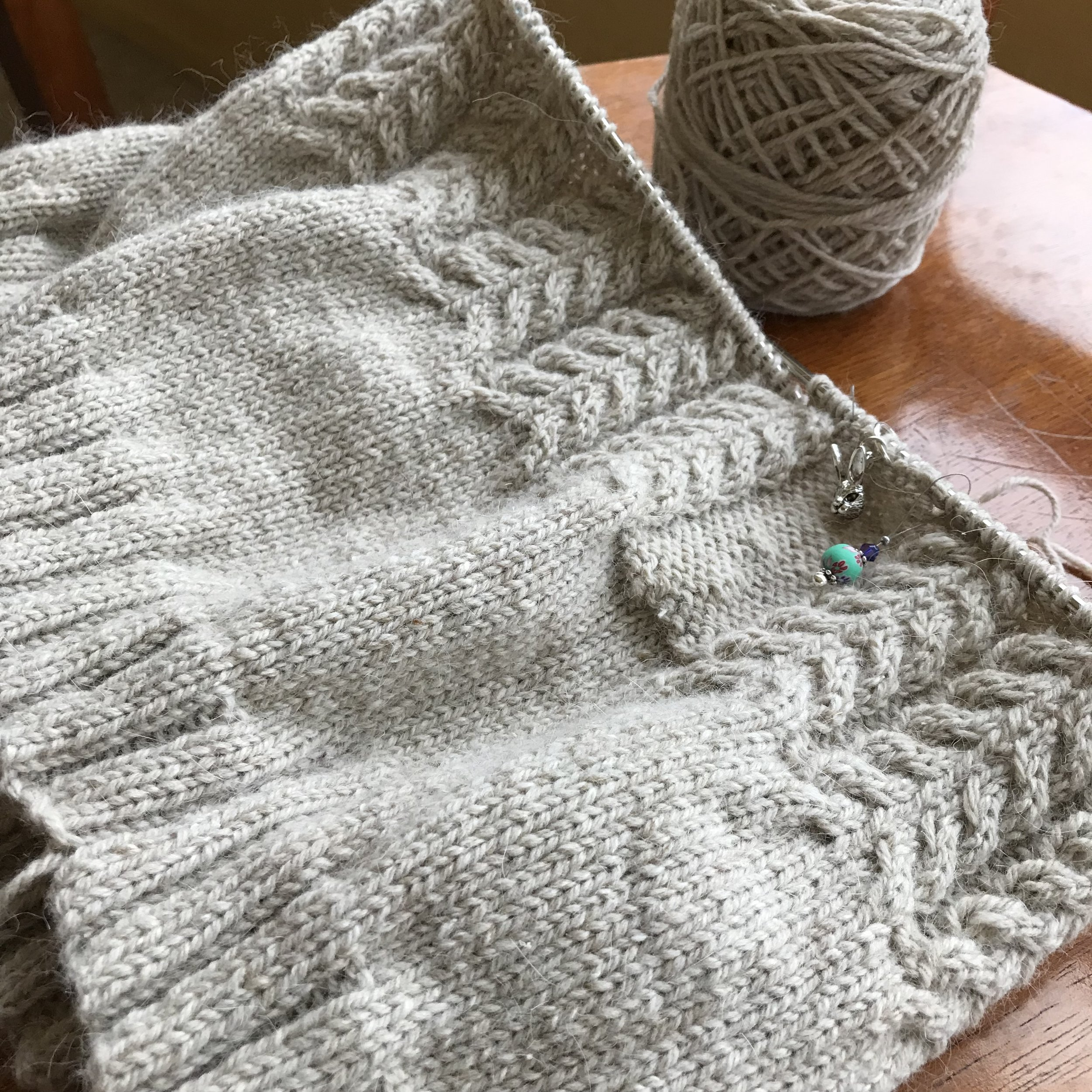 January Gansey - As part of the Winter Sweater KAL (every Friday, 5-7pm—join us!), I'm working on the January Gansey in Kenzie, color Pavlova, a slightly tweedy oatmeal color.This week, I knit well into the cabled body (this sweater is bottom-up, in the round up to the armholes). But I have plenty of cables ahead! Knit on US 3s to a gauge of 6 stitches per inch, this is a dense, warm fabric.