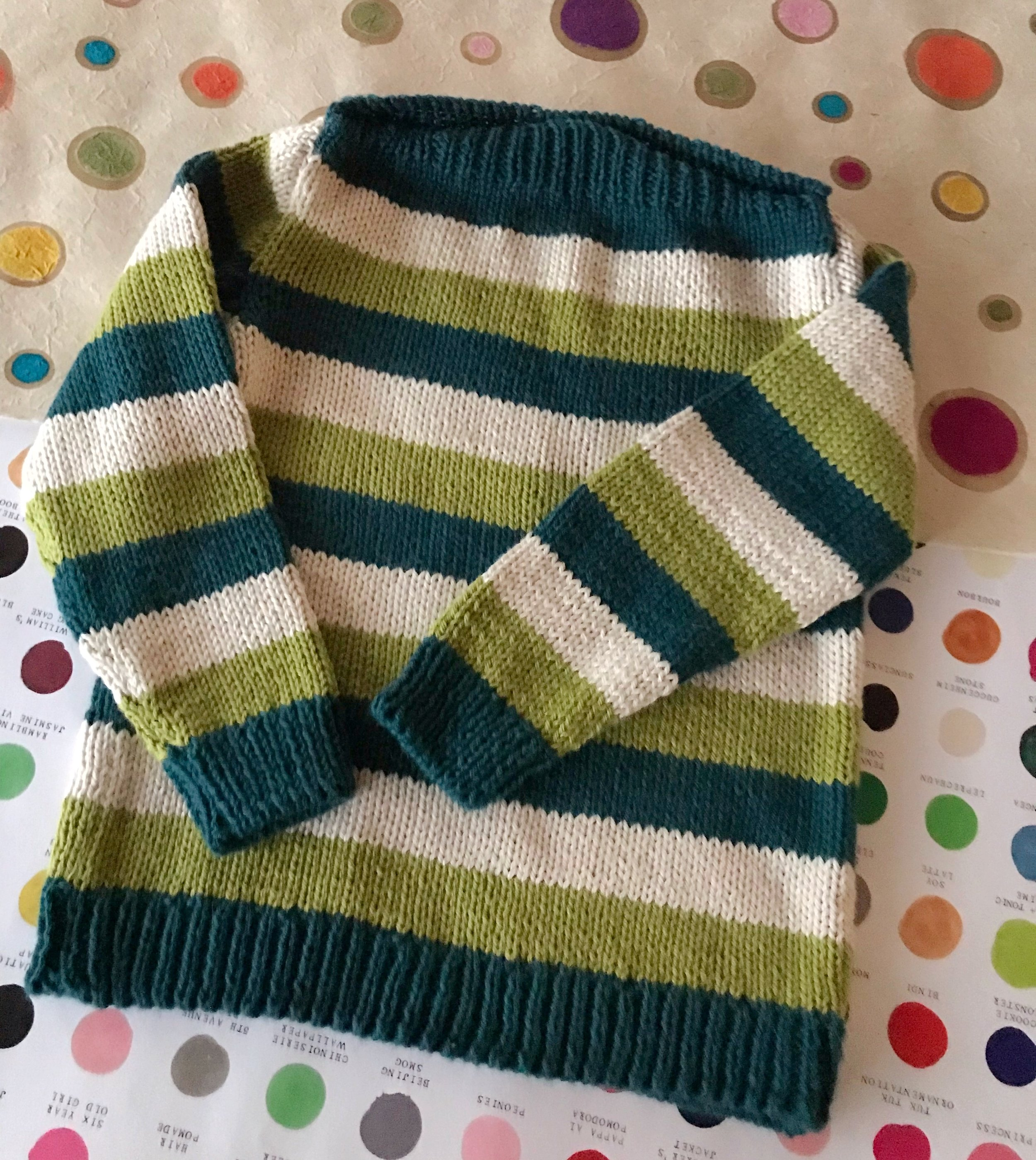 East Fork Pullover - Not only are wide stripes on kids' sweaters cute, they work up fast! The East Folk Pullover is worked in pieces and seamed, but the stripes make it easy to match up. The boat neck is wide, making it easy to put on and take off, and the buttons at the shoulders add a little personality.
