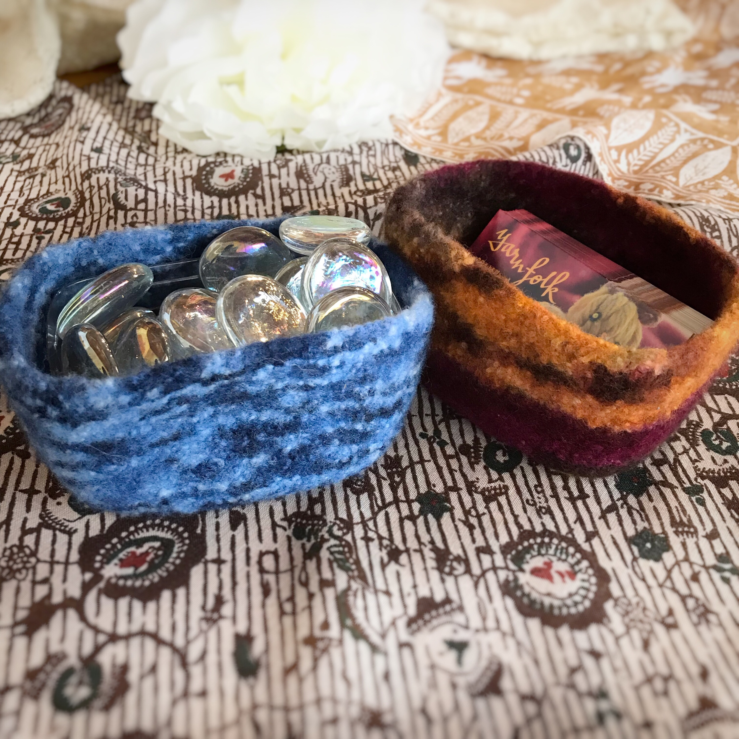 CURRENT CLASSES & EVENTS - Project CircleJuly 26, 5:00-7:00pm | no charge.Join us to work on your longer term projects!Cast On/Bind Off [two spaces left]July 27, 10:00am-2:00pm | Instructor: Sandy Buzzelli | $40 + materialsThe look and fit of our knitted items is greatly influenced by the cast on and bind off methods we choose. If we need stretch for the cuff of a sock, we might choose one of several variations of the long tail cast on for cuff-down socks or the suspended bind off for toe-up socks. For a beautiful finish on a ribbed collar, we might choose the tubular cast on/bind off. If we are binding off after knitting garter stitch, we might use the sewn bind off.We'll explore these and many more ways to get stitches on and off our needles (crochet cast on and bind off, Emily Ocker's cast on, 3-needle bind off, I-cord bind off), and we'll come away with a general understanding of when and how to use each method.As an added bonus, we'll also discuss how to deal with two pesky issues that crop up when binding off: that loose last stitch when doing the traditional bind off and the jog that happens when binding off in circular knitting.Prerequisite: you should know how to cast on, knit, purl, and bind off.Felting By Hand [DATE CORRECTION]August 3, 10:00am-1:00pm | Instructor: Sandy Buzzelli | $30 + materialsYou'll never run out of uses for this adorable little felted basket! It's perfect for holding jewelry, keys, business cards or your favorite candy. Tucked near your knitting spot, it's an especially pretty way to keep your knitting notions handy.The basket knits up very quickly and easily, and felting it by hand gives it a classic, finished look.You'll be knitting your basket on your own before class meets so that we'll be ready to jump right in to exploring in-depth how to felt by hand (vs. felting in a washing machine).Please note: felting by hand is a mildly physical activity. It involves standing, bending over a sink, and lifting a large bowl of water. In add