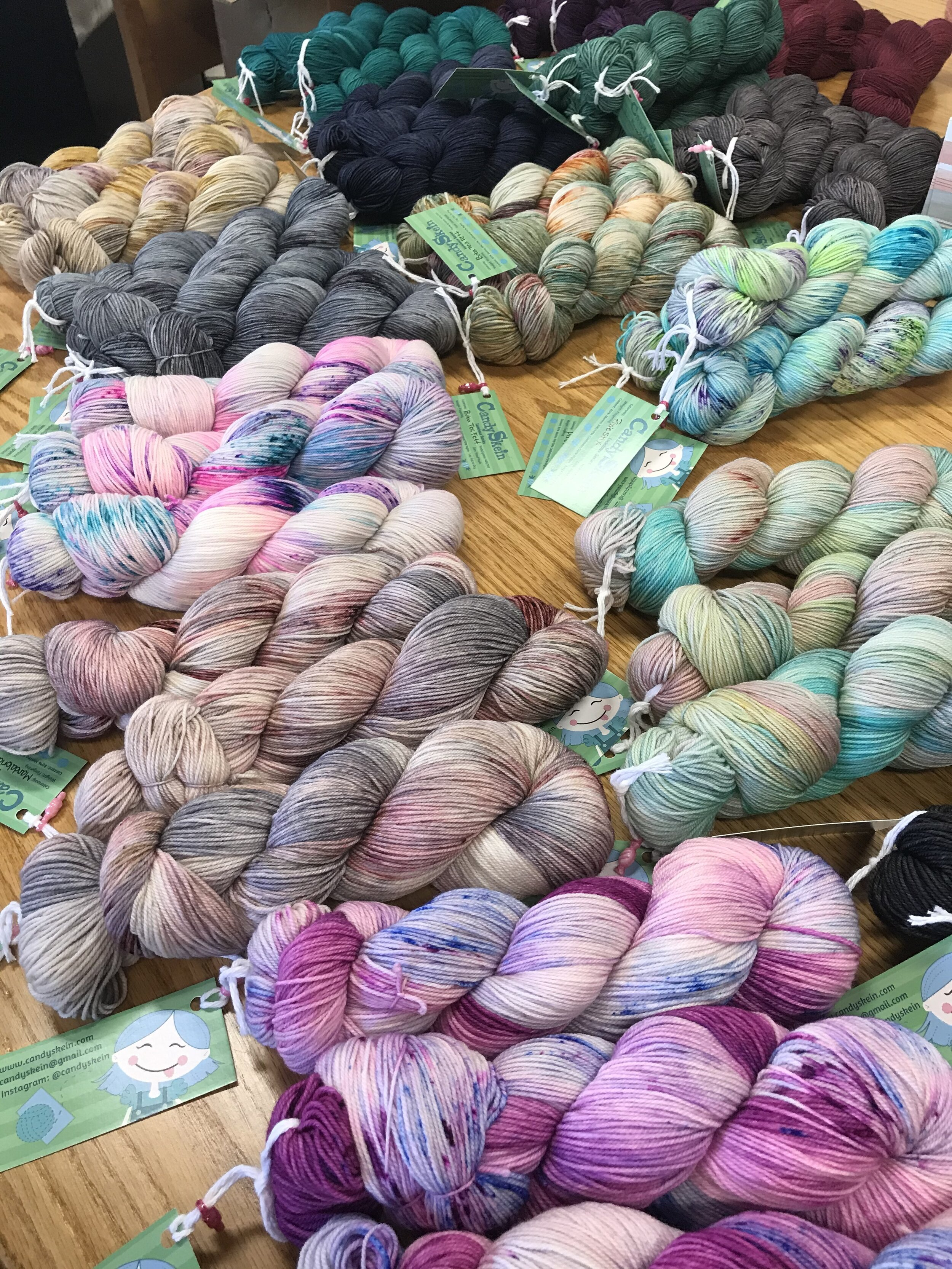 Sixteen colors of Candy Skein Luscious Fingering yarn